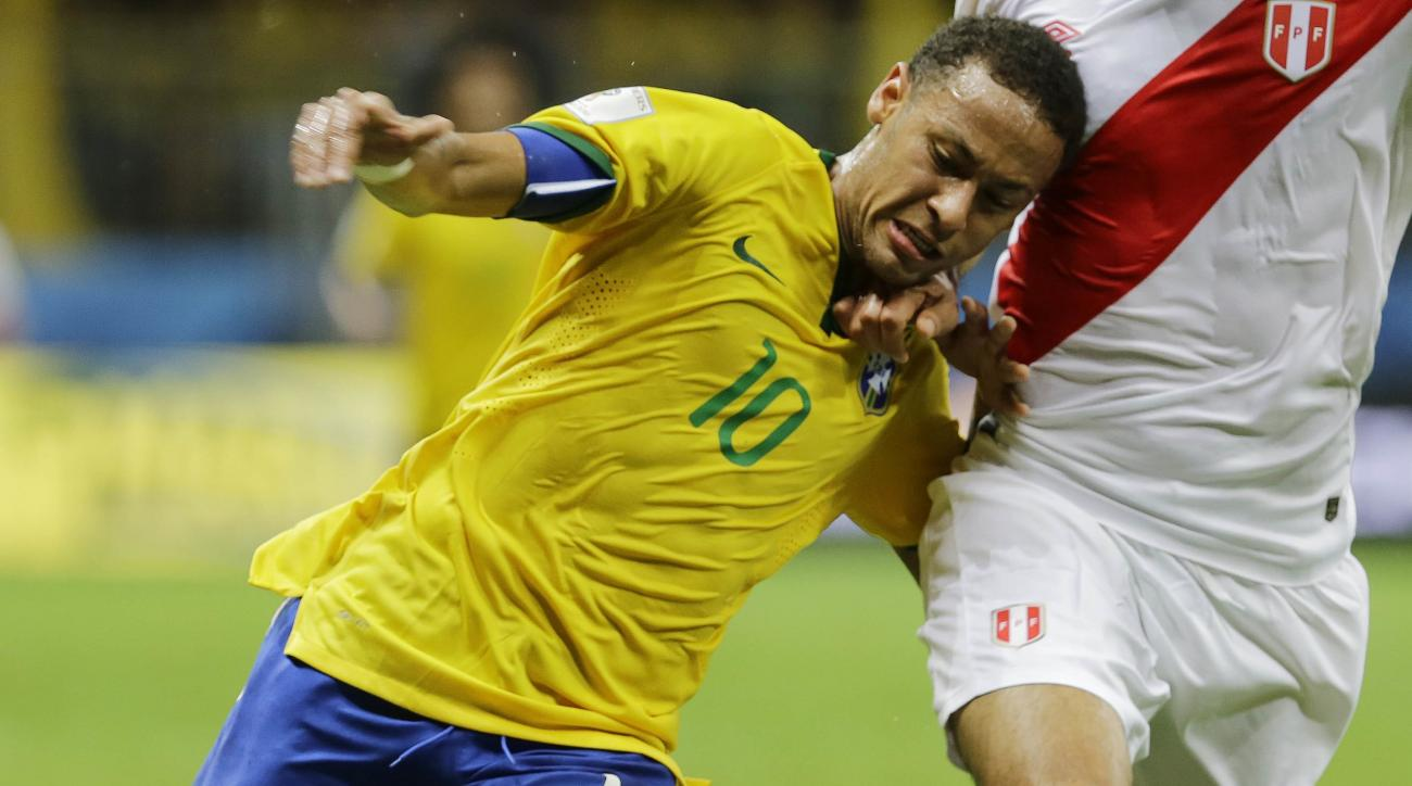 FILE - In this Nov. 17, 2015, file photo, Brazil's Neymar, left, fights for the ball with Peru's Carlos Zambrano during a 2018 World Cup qualifying soccer match in Salvador, Brazil.Brazil has named its Olympic soccer team, which includes two key players w