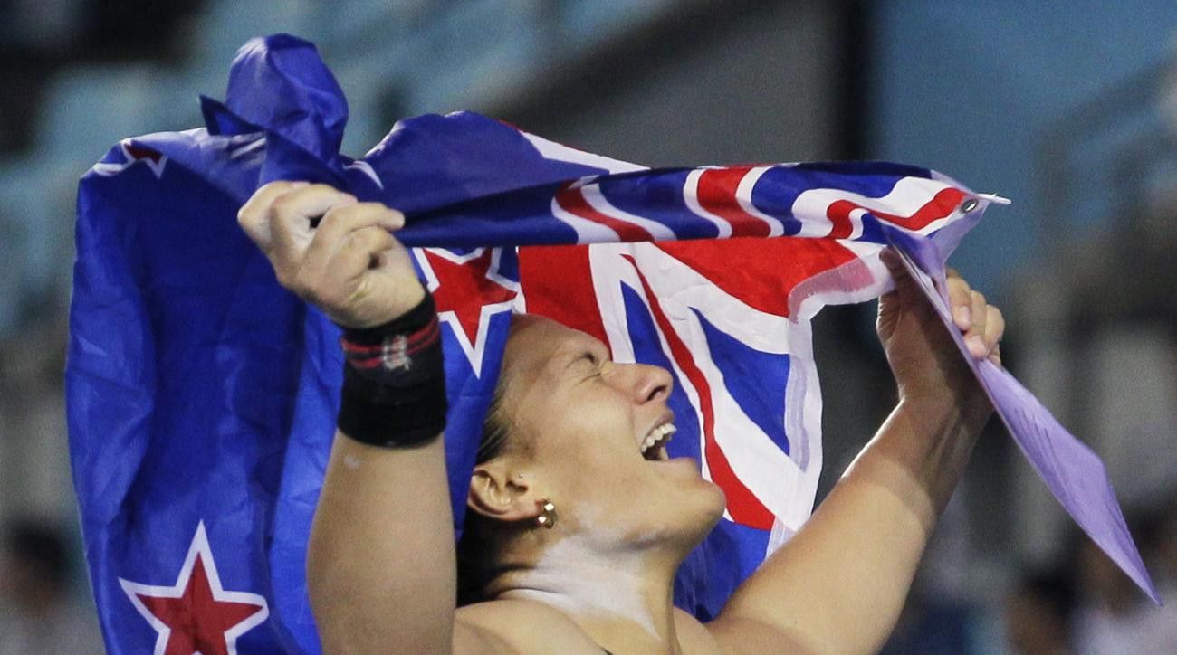 FILE - In this Aug. 29, 2011, file photo, New Zealand's Valerie Adams celebrates winning gold in the Women's Shot Put final at the World Athletics Championships in Daegu, South Korea. Adams will attempt at the Rio de Janeiro Games to become the first woma