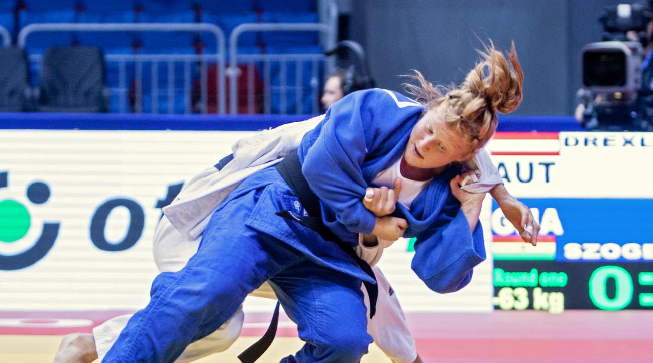In this handout picture taken in August 2014, Ghana's Szandra Szogedi, front, competes against Austria's Hilde Drexler during the Judo World Championships in Chelyabinsk, Russia. When Hungarian native Szandra Szogedi steps onto the judo mat at the Rio de
