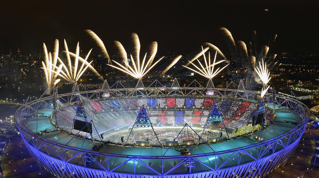 FILE - In this July 28, 2012, file photo, fireworks illuminate the sky over the Olympic Stadium during Opening Ceremonies at the 2012 Summer Olympics in London. Always splashy affairs, the parade of athletes this time around will take place Friday night,