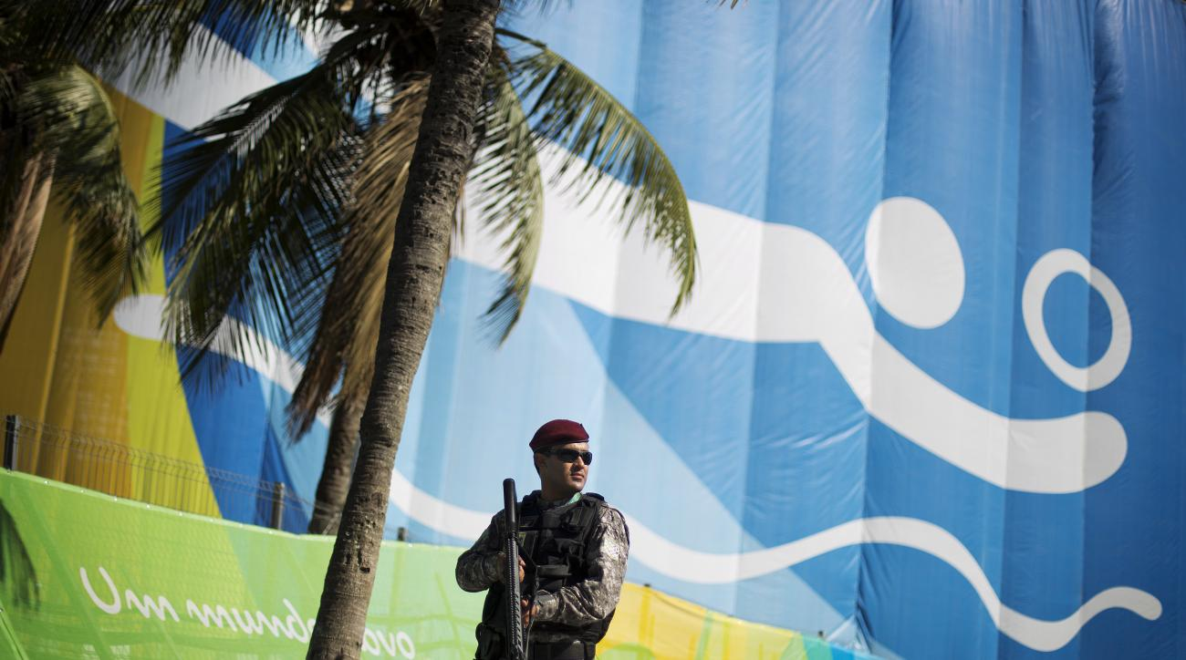 A National Security Force officer patrols outside the beach volleyball arena along Copacabana Beach ahead of the upcoming 2016 Summer Olympics in Rio de Janeiro, Brazil, Tuesday, Aug. 2, 2016. (AP Photo/David Goldman)