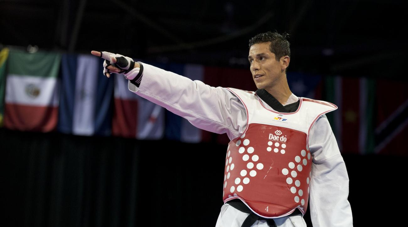 FILE - In this Tuesday, July 21, 2015 file photo, Steven Lopez of the U.S. reacts after winning a bronze medal by defeating Venezuela's Javier Medina in the men's taekwondo under-80kg category at the Pan Am Games in Mississauga, Ontario. The first time Lo