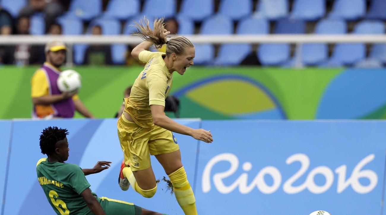 Sweden's Magdalena Eriksson tries to control de ball past South Africa's Mamello Makhabane during the opening match of the Women's Olympic Football Tournament between Sweden and South Africa at the Rio Olympic Stadium in Rio de Janeiro, Brazil, Wednesday,