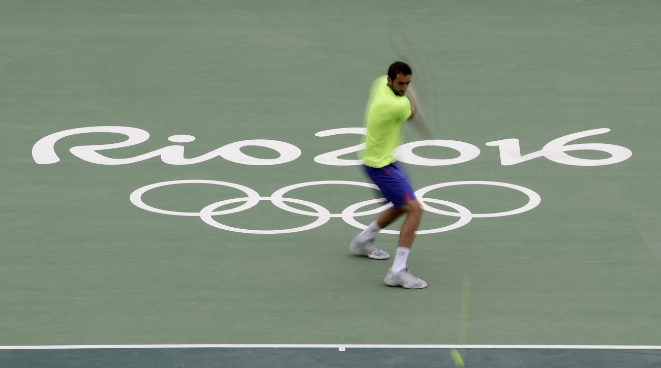 Croatia's Marin Cilic practices during a training session at the Olympic Tennis Center at the Olympic park in Rio de Janeiro, Brazil, Wednesday, Aug. 3, 2016. The Summer 2016 Olympics is scheduled to open Aug. 5. (AP Photo/Charlie Riedel)