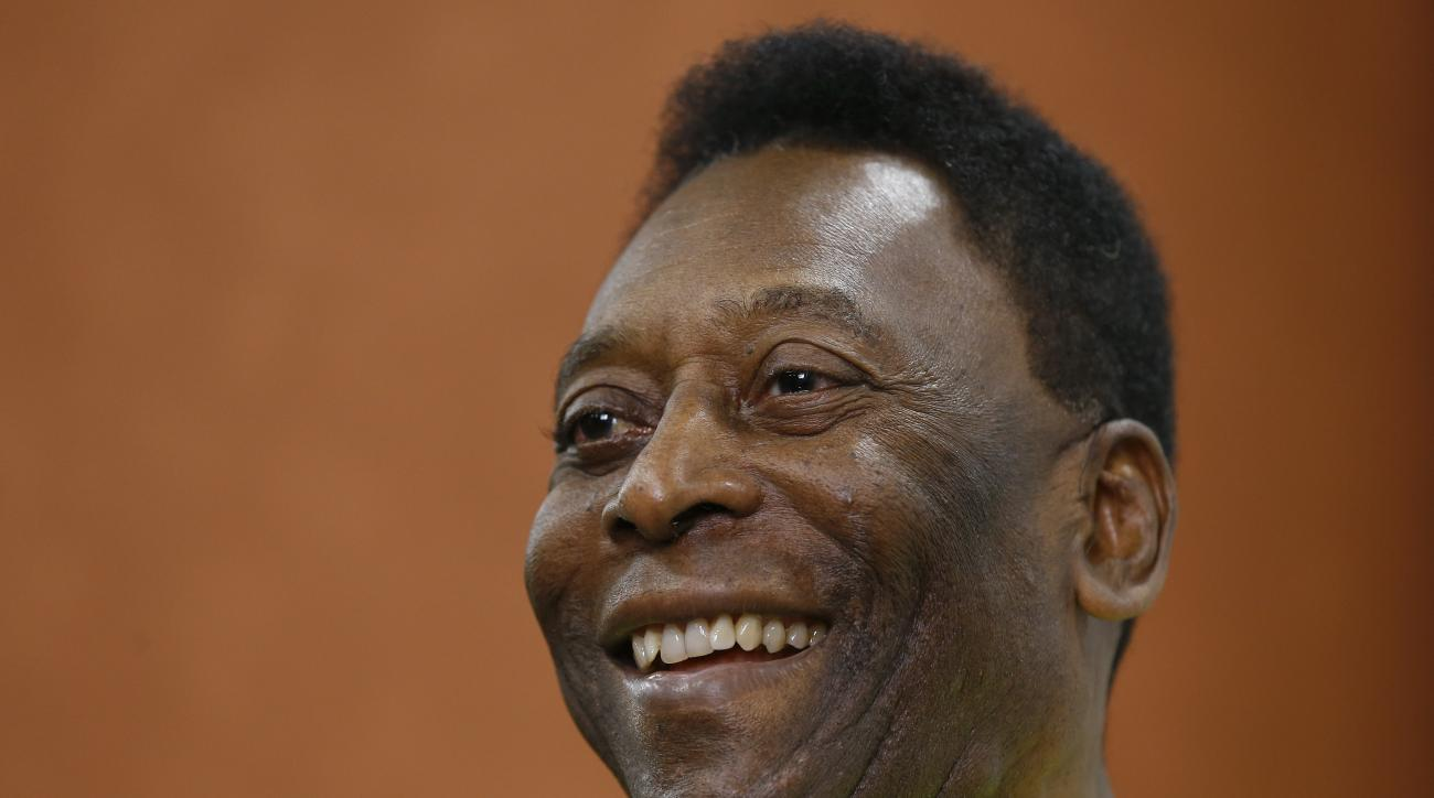FILE - In this March 20, 2015 file photo, Brazilian soccer legend Pele smiles during a media opportunity at a restaurant in London. Brazilian football great Pele has married for a third time in a private ceremony. The 75-year-old Pele married businesswoma