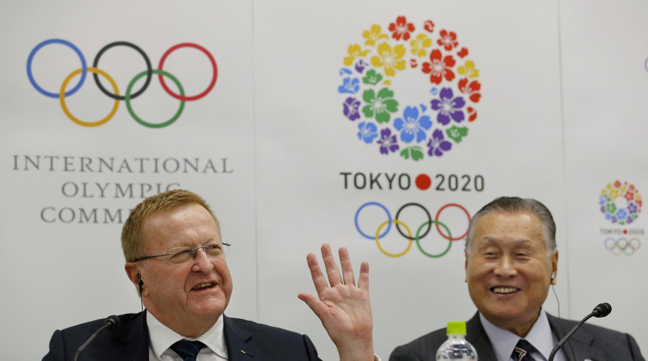 International Olympic Committee (IOC) Vice President and IOC Coordination Commission for Tokyo 2020 Chair John Coates, left, speaks as Tokyo 2020 Olympics President Yoshiro Mori smiles during a press conference following the 4th Project Review for the Oly