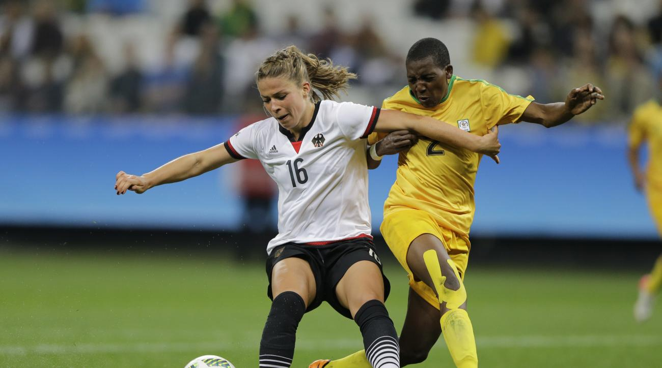 Germany's Melanie Leupolz, left, fight for the ball with Zimbabwe's Lynett Motokuto during the 2016 Summer Olympics football match at the Arena Corinthians in Sao Paulo, Brazil, Wednesday, Aug. 3, 2016. (AP Photo/Nelson Antoine)