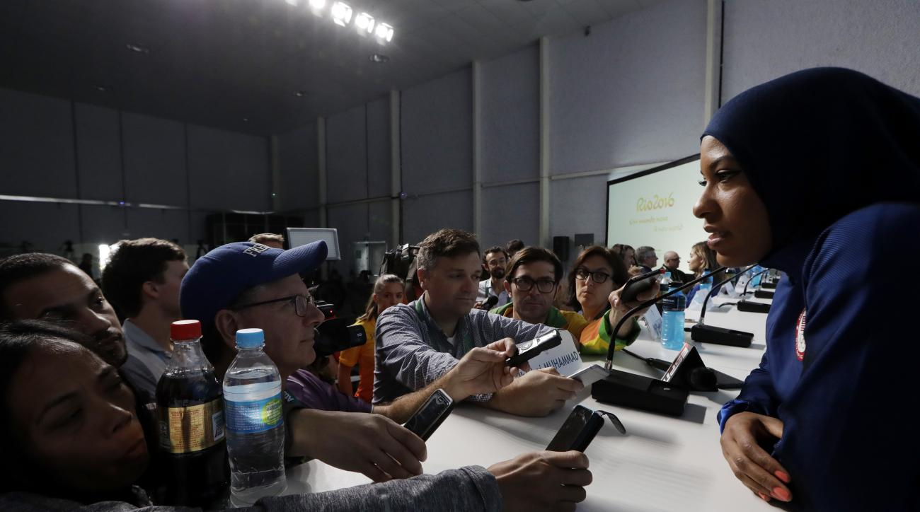 United States fencer Ibtihaj Muhammad talks with journalists during a press conference she held ahead of the 2016 Summer Olympics in Rio de Janeiro, Brazil, Thursday, Aug. 4, 2016. (AP Photo/Andrew Medichini)