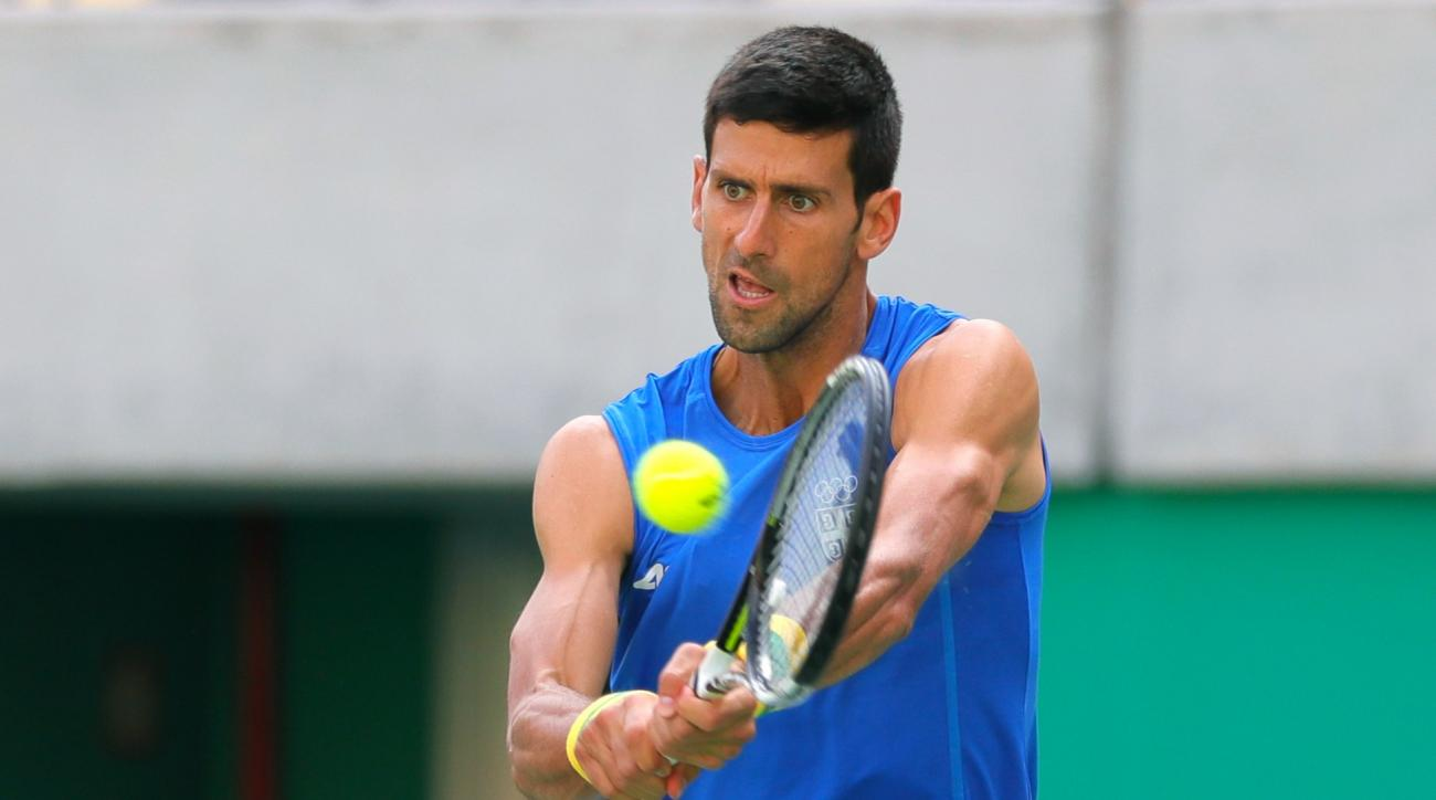 Serbia's Novak Djokovic returns a ball during a practice session on the central court ahead of the upcoming 2016 Summer Olympics in Rio de Janeiro, Brazil, Tuesday, Aug. 2, 2016. (AP Photo/Vadim Ghirda)
