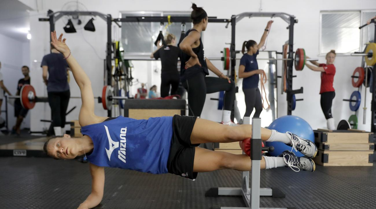 United States' Courtney Thompson works out in the weight room after practicing with her teammates at the Navy School High Performance Training Center before the start of the 2016 Summer Olympics in Rio de Janeiro, Brazil, Thursday, Aug. 4, 2016. (AP Photo