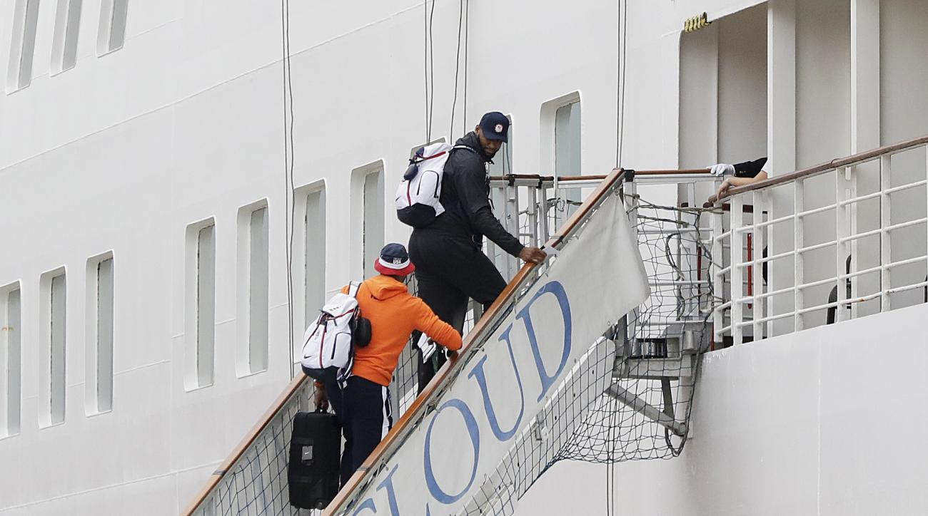 DeMarcus Cousins, center right, and Carmelo Anthony, of the United States men's basketball team, board the Silver Cloud cruise ship upon arriving for the 2016 Summer Olympics in Rio de Janeiro, Brazil, Wednesday, Aug. 3, 2016. The men's and women's team w