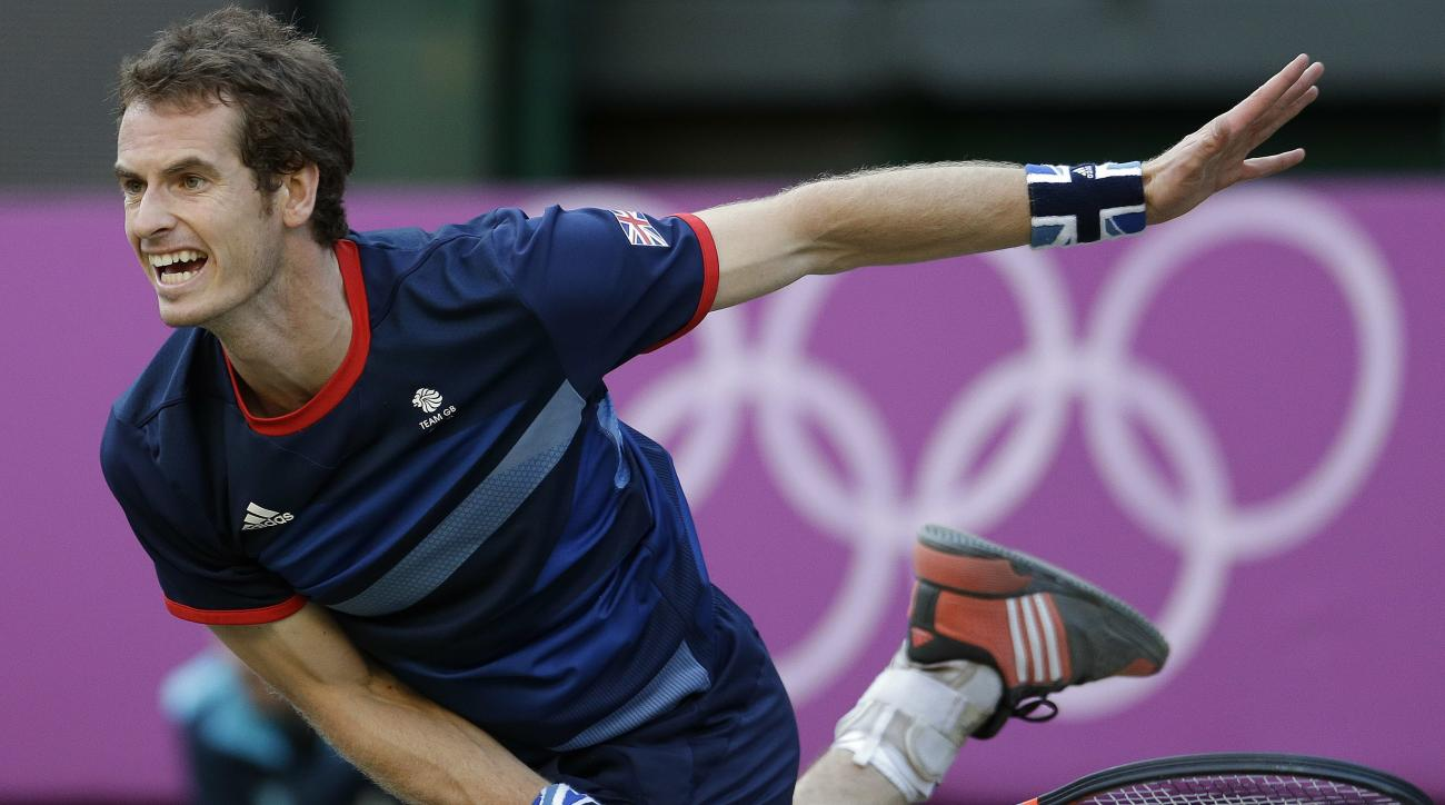 FILE - In this Aug. 3, 2012, file photo, Andy Murray of Great Britain serves to Novak Djokovic of Serbia at the All England Lawn Tennis Club in Wimbledon, London at the 2012 Summer Olympics. Consider what Britain's Murray said, the day after winning Wimbl