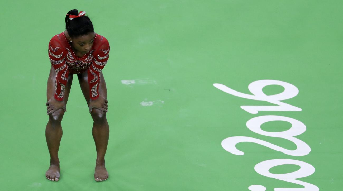 United States' Simone Biles waits her turn to train on the beam ahead of the 2016 Summer Olympics in Rio de Janeiro, Brazil, Thursday, Aug. 4, 2016. (AP Photo/Julio Cortez)
