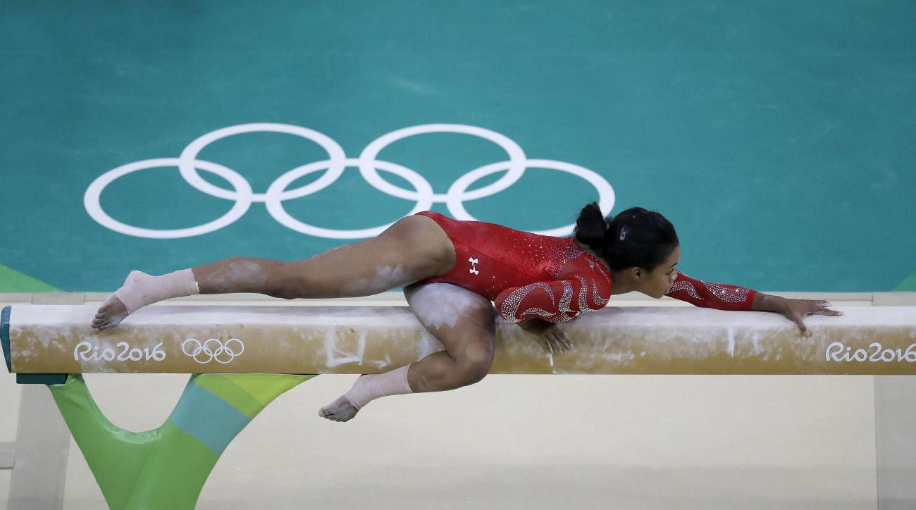 United States' Gabrielle Douglas trains on the balance beam ahead of the 2016 Summer Olympics in Rio de Janeiro, Brazil, Thursday, Aug. 4, 2016. (AP Photo/Julio Cortez)