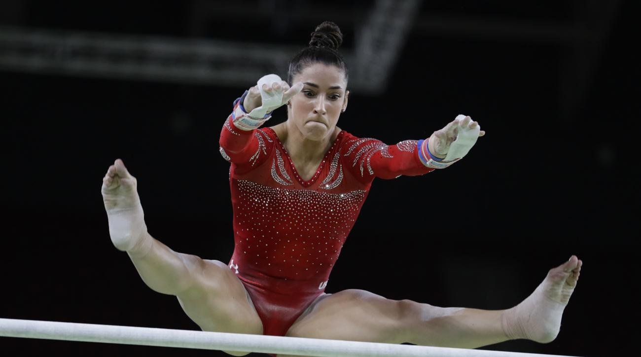 trains on the  ahead of the 2016 Summer Olympics in Rio de Janeiro, Brazil, Thursday, Aug. 4, 2016. (AP Photo/Rebecca Blackwell) United States' Alexandra Raisman trains on the uneven bars ahead of the 2016 Summer Olympics in Rio de Janeiro, Brazil, Thursd