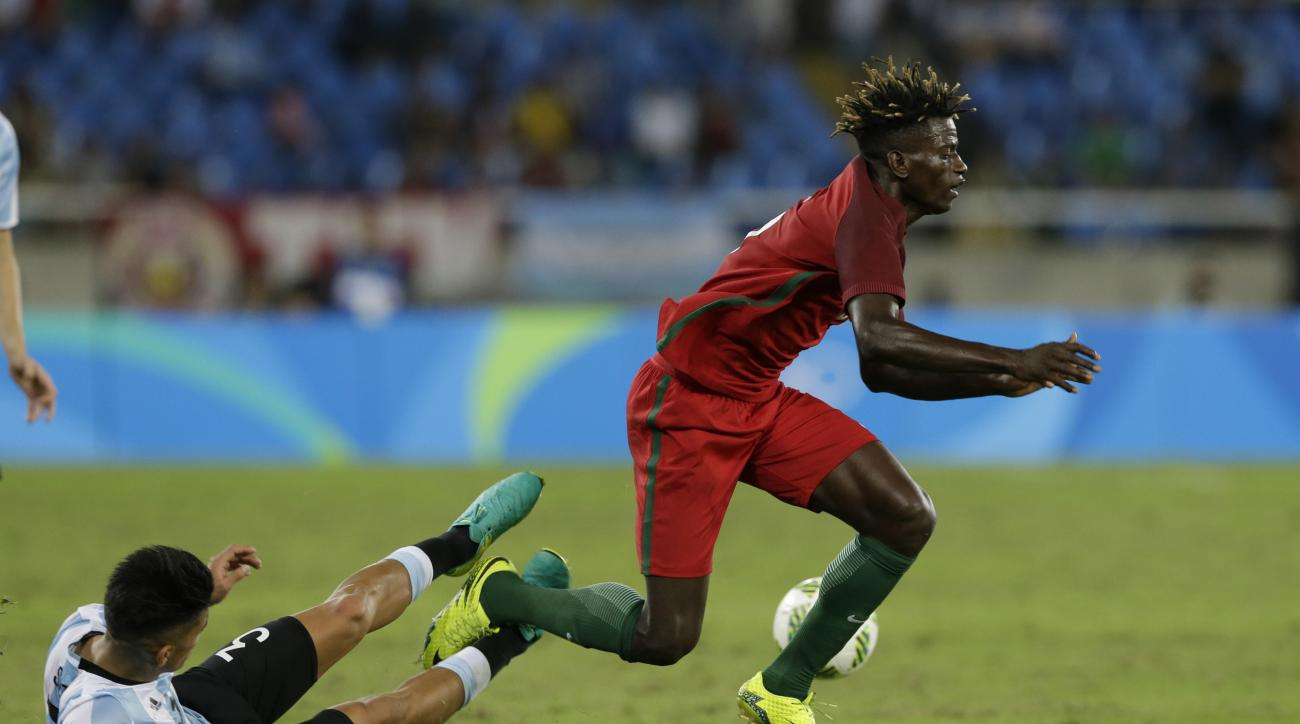 Portugal's Edgar Le, right, is tackled by Argentina's Alexis Soto during a group D match of the men's Olympic football tournament at the Rio Olympic Stadium in Rio De Janeiro, Brazil, Thursday, Aug. 4, 2016. Portugal won 2-0. (AP Photo/Leo Correa)