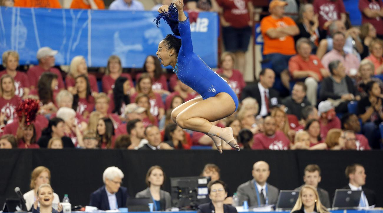 FILE - In this April 16, 2016, file photo, UCLA's Sophina DeJesus celebrates after her floor exercise routine during the NCAA women's gymnastics championships in Fort Worth, Texas. DeJesus managed to do something this year that three-time world champion S