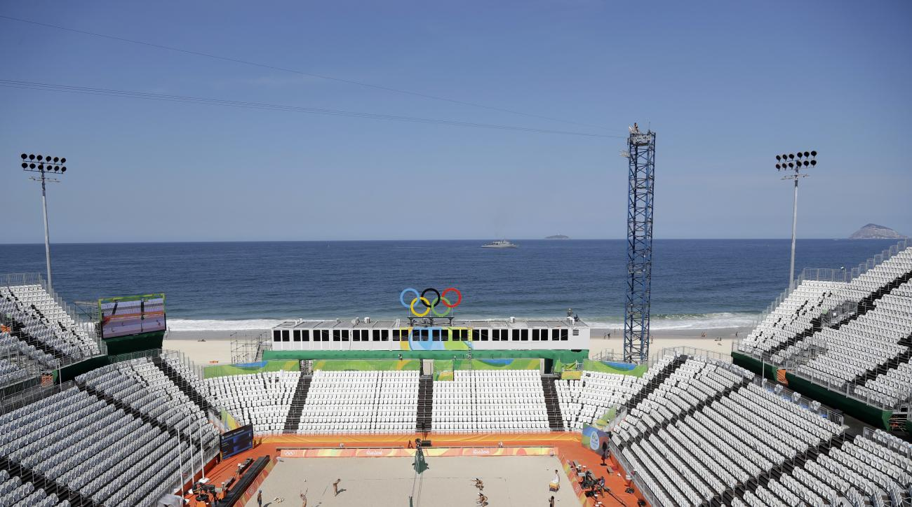 The Copacabana beach volleyball arena is seen as competitors from Italy and Netherlands play during a training session at the 2016 Summer Olympics in Rio de Janeiro, Brazil, Friday, Aug. 5, 2016. (AP Photo/Marcio Jose Sanchez)
