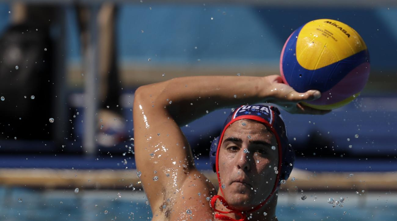 United States's Luca Cupido, shoots during a water polo training session at the Maria Lenk Aquatic Center ahead of the 2016 Summer Olympics in Rio de Janeiro, Brazil, Friday, Aug. 5, 2016. (AP Photo/Eduardo Verdugo)