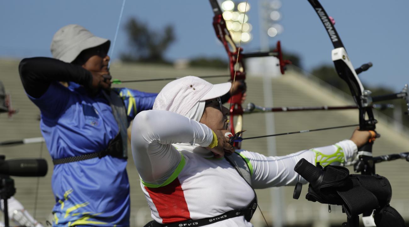 Iran's Zahra Nemati, right, aims for the target during an individual ranking round at the 2016 Summer Olympics in Rio de Janeiro, Brazil, Friday, Aug. 5, 2016. (AP Photo/Alessandra Tarantino)