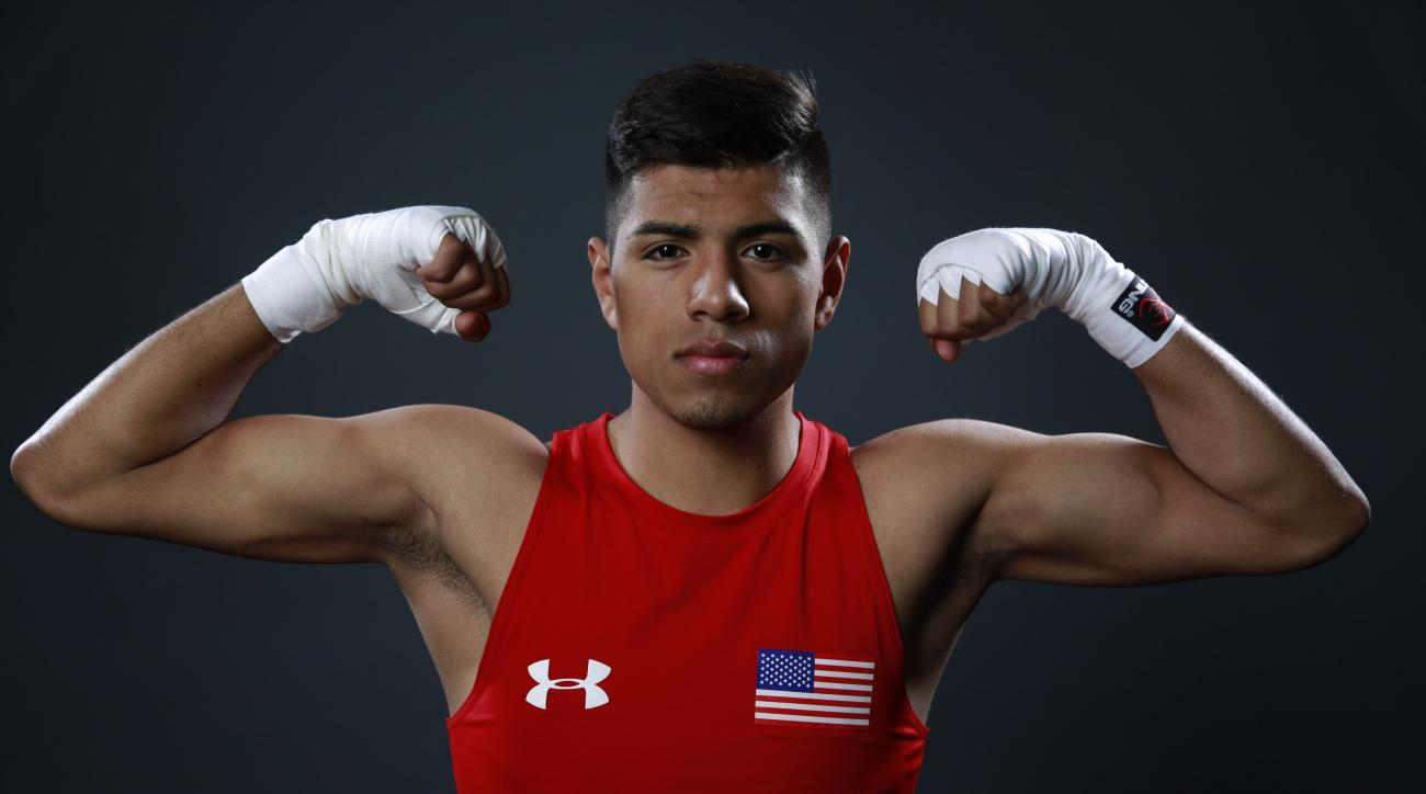 USA Boxing team member Carlos Balderas poses for photo at the 2016 Team USA Media Summit Wednesday, March 9, 2016, in Beverly Hills, Calif. (AP Photo/Damian Dovarganes)