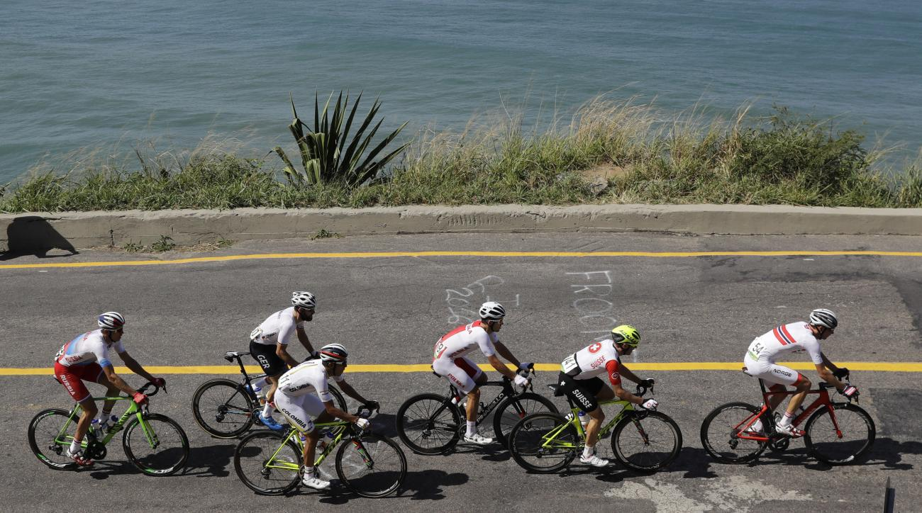 Norway's Sven Erik Bystrom, right, leads the pack, followed by, from right to left, Michael Albasini of Switzerland, Michal Kwiatkowski of Poland, Jarlinson Pantano Gomez of Colombia, Simon Geschke of Germany and Pavel Kochetkov of Russia during the men's