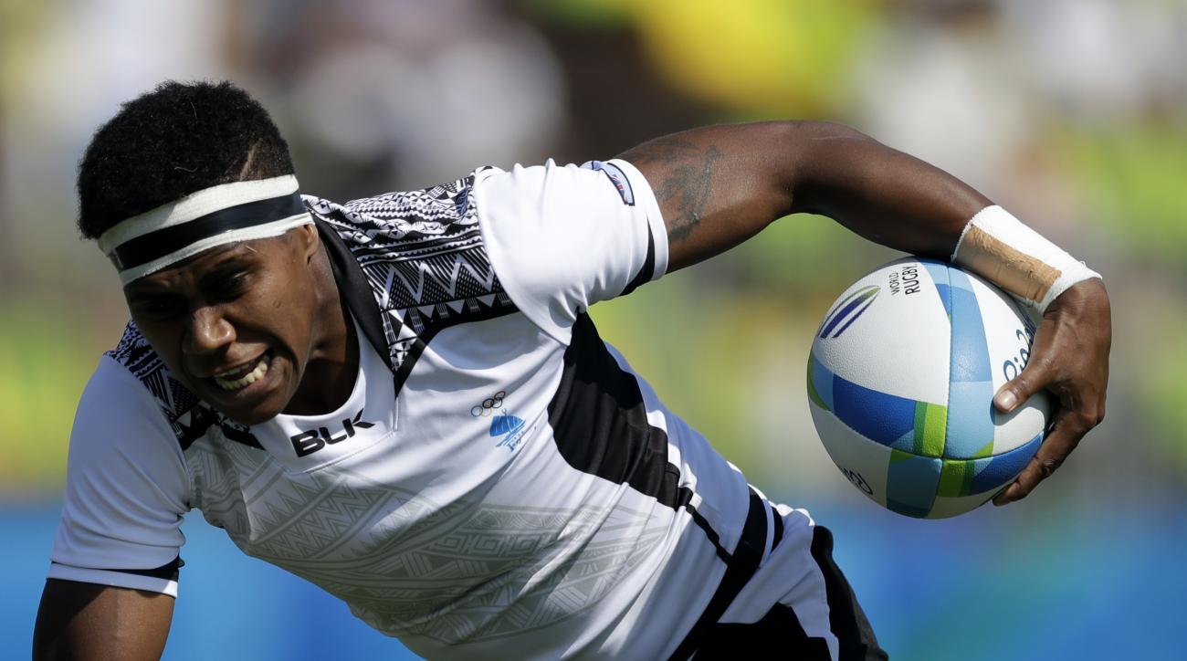 Fiji's Litia Naiqato, front, is tackled by USA's Lauren Doyle, during the women's rugby sevens match between USA and Fiji at the Summer Olympics in Rio de Janeiro, Brazil, Saturday, Aug. 6, 2016. (AP Photo/Themba Hadebe)
