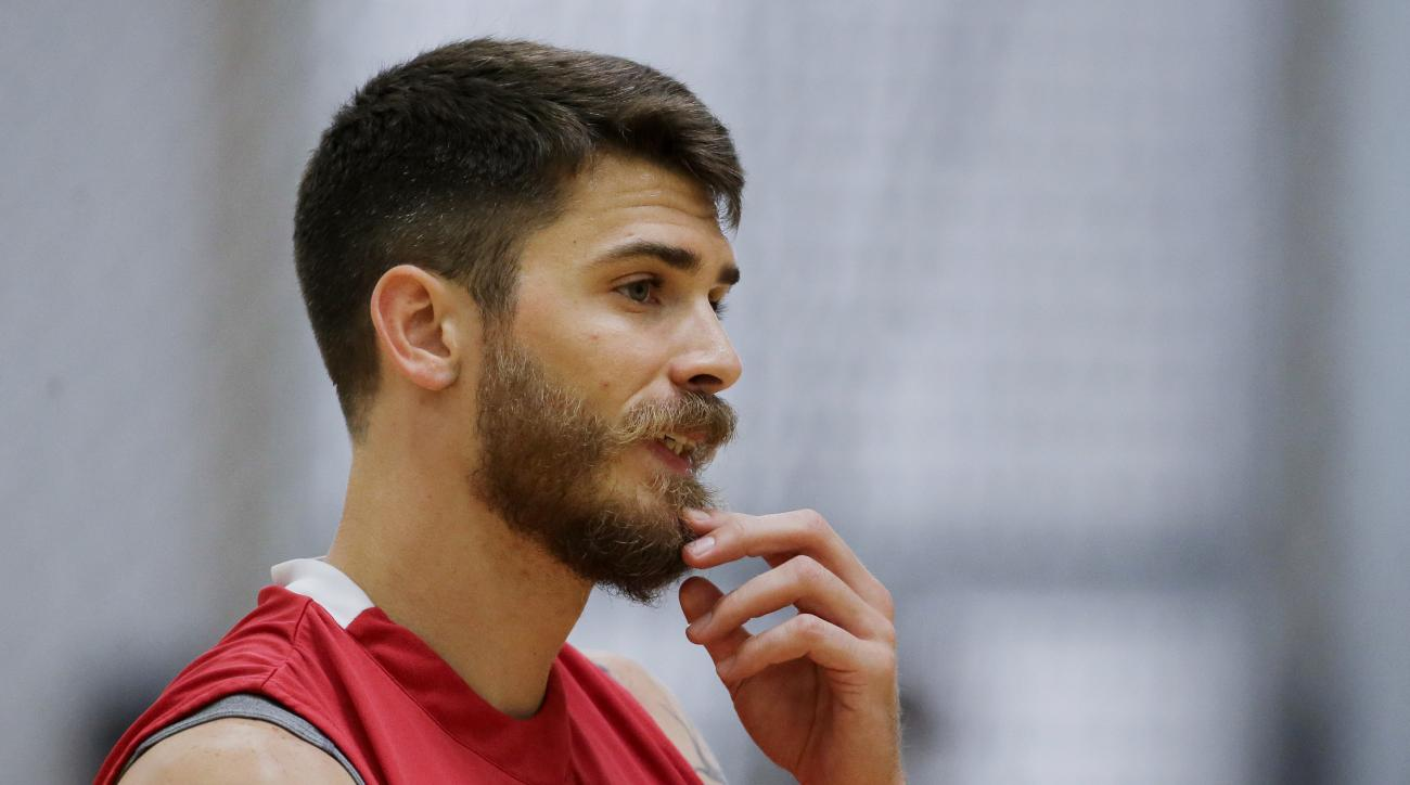 In this May 25, 2016 photo, Olympic volleyball player Matt Anderson, of the United States, watches during practice, in Anaheim, Calif.  In late 2014, Anderson found himself in a deep funk and made that daunting decision to step away from volleyball to fin