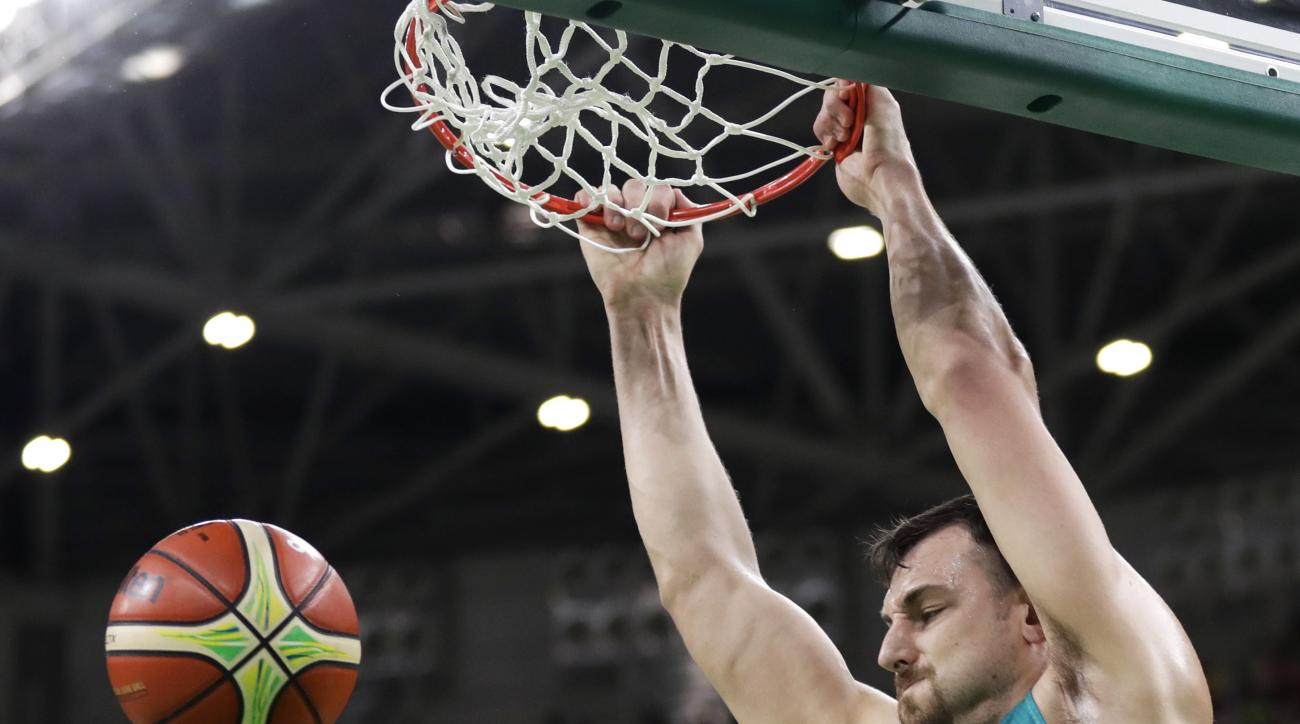 Australia's Australia's Andrew Bogut, right, dunks the ball over France's Rudy Gobert during a basketball game at the 2016 Summer Olympics in Rio de Janeiro, Brazil, Saturday, Aug. 6, 2016. (AP Photo/Charlie Neibergall)