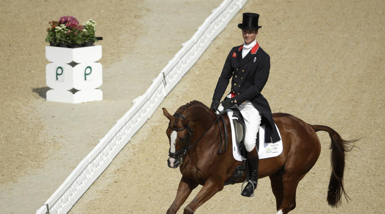 William Fox-Pitt, of Great Britain, rides Chilli Morning in the equestrian eventing dressage competition at the 2016 Summer Olympics in Rio de Janeiro, Brazil, Saturday, Aug. 6, 2016. (AP Photo/John Locher)