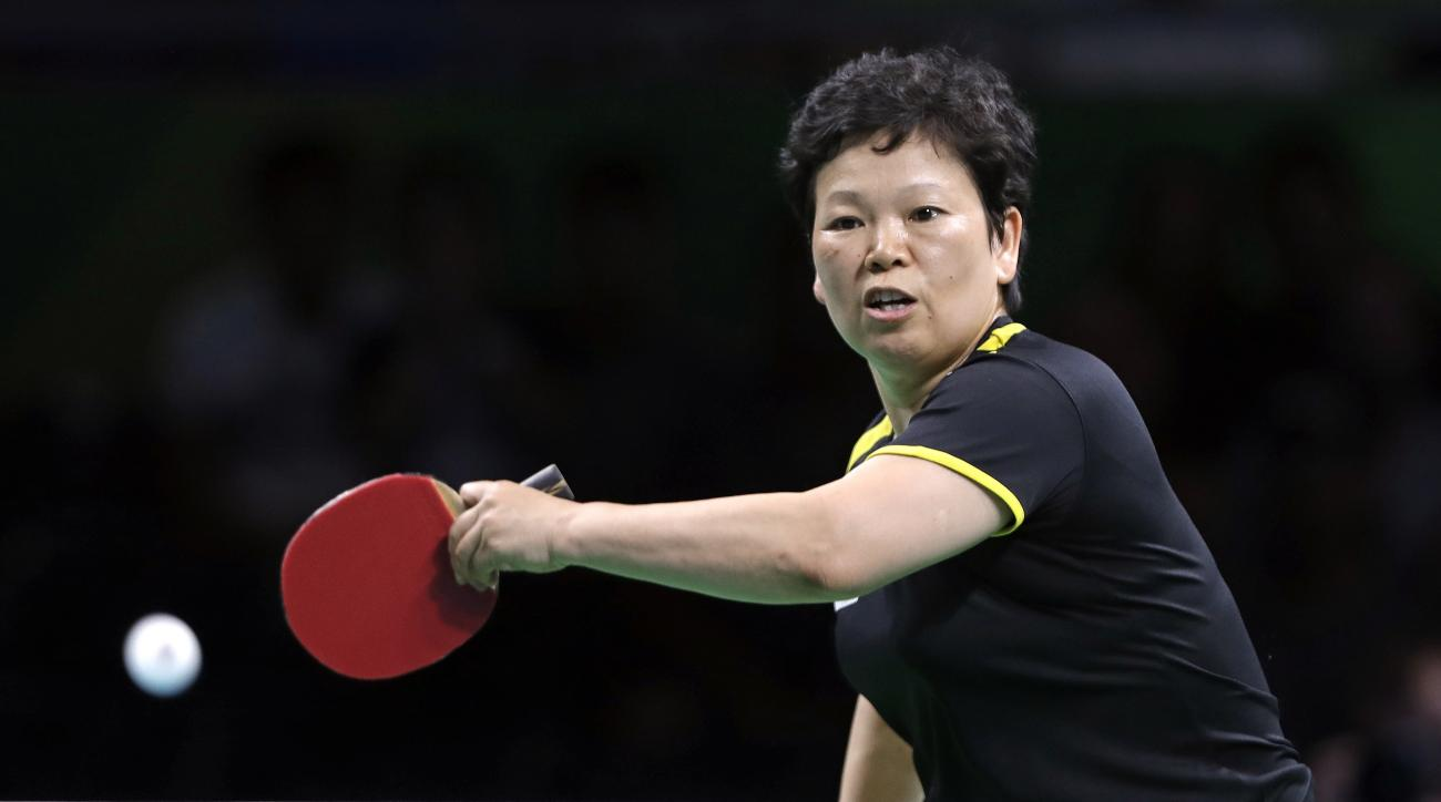 Ni Xia Lian, of Luxembourg, returns a shot to Caroline Kumahara, of Brazil, during their table tennis match at the 2016 Summer Olympics in Rio de Janeiro, Brazil, Saturday, Aug. 6, 2016. (AP Photo/Petros Giannakouris)
