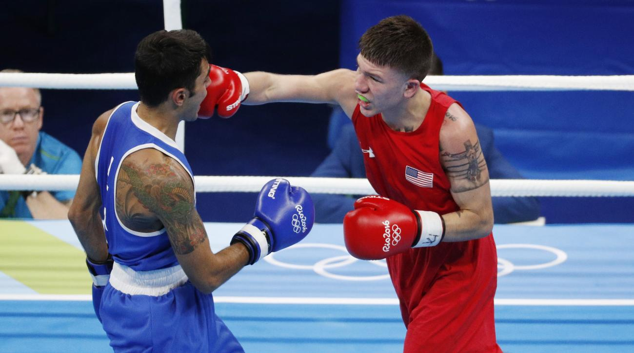 United State's Nico Hernandez, right, fights Italy's Manuel Cappai during a men's light flyweight 49-kg preliminary boxing match at the 2016 Summer Olympics in Rio de Janeiro, Brazil, Saturday, Aug. 6, 2016. (AP Photo/Vincent Thian)
