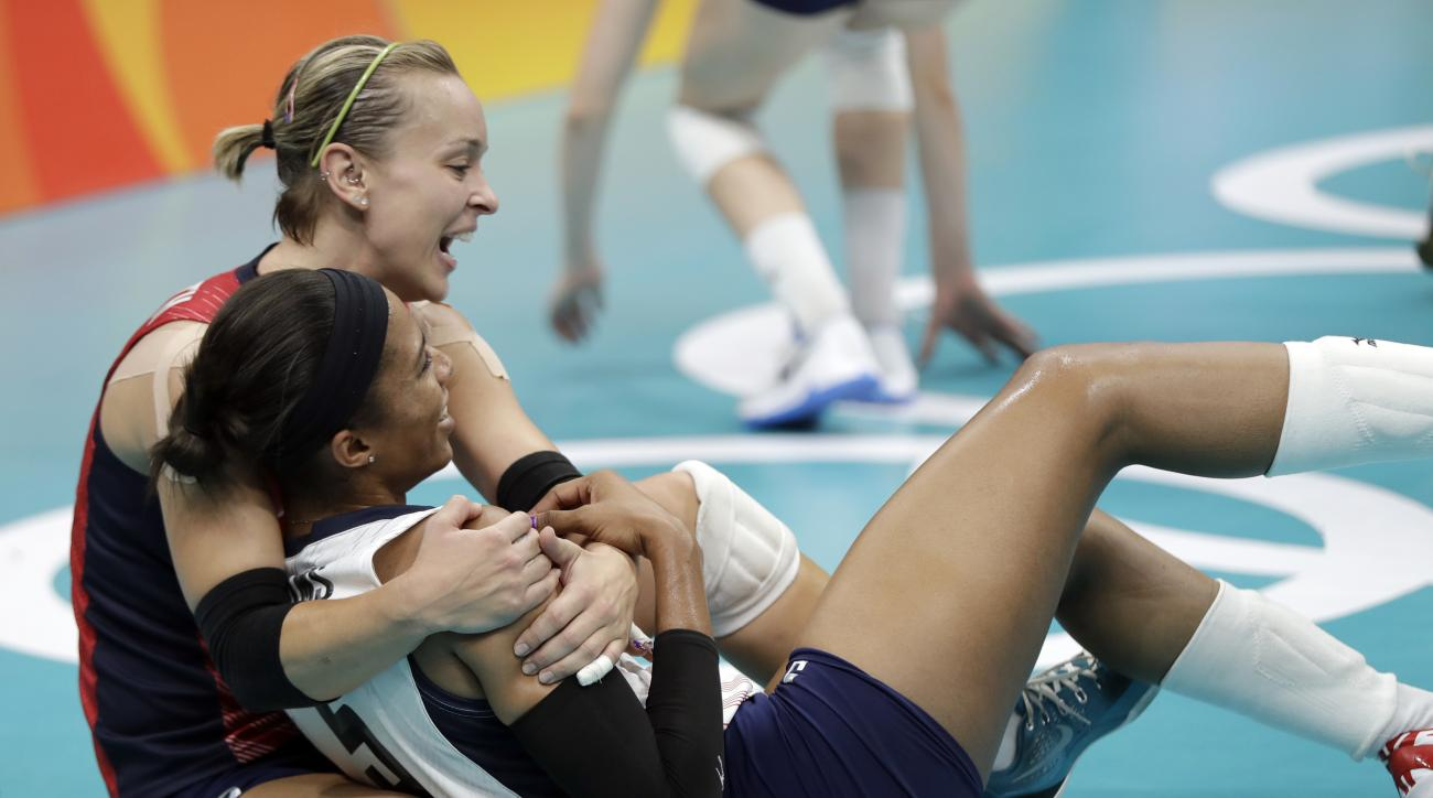 United States' Kayla Banwarth and teammate Rachael Adams, front, celebrate their victory over Puerto Rico during a women's preliminary volleyball match at the 2016 Summer Olympics in Rio de Janeiro, Brazil, Saturday, Aug. 6, 2016. (AP Photo/Matt Rourke)