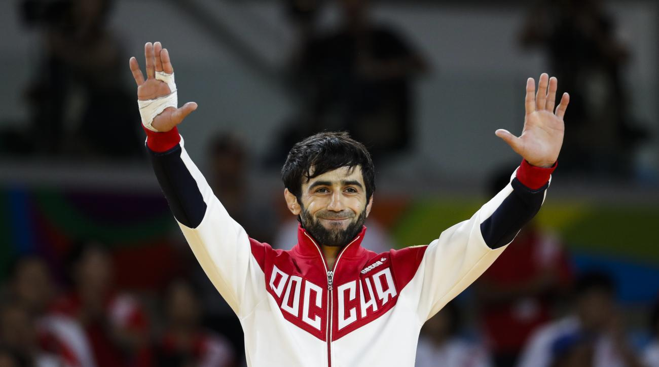Russia's Beslan Mudranov celebrates after he wins the men's 60-kg judo competition at the 2016 Summer Olympics in Rio de Janeiro, Brazil, Saturday, Aug. 6, 2016. (AP Photo/Markus Schreiber)