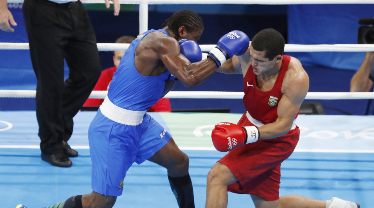Brazil's Michel Borges, right, fights Cameroon's Hassan N'Dam during a men's light heavyweight 81-kg preliminary boxing match at the 2016 Summer Olympics in Rio de Janeiro, Brazil, Saturday, Aug. 6, 2016. (AP Photo/Vincent Thian)