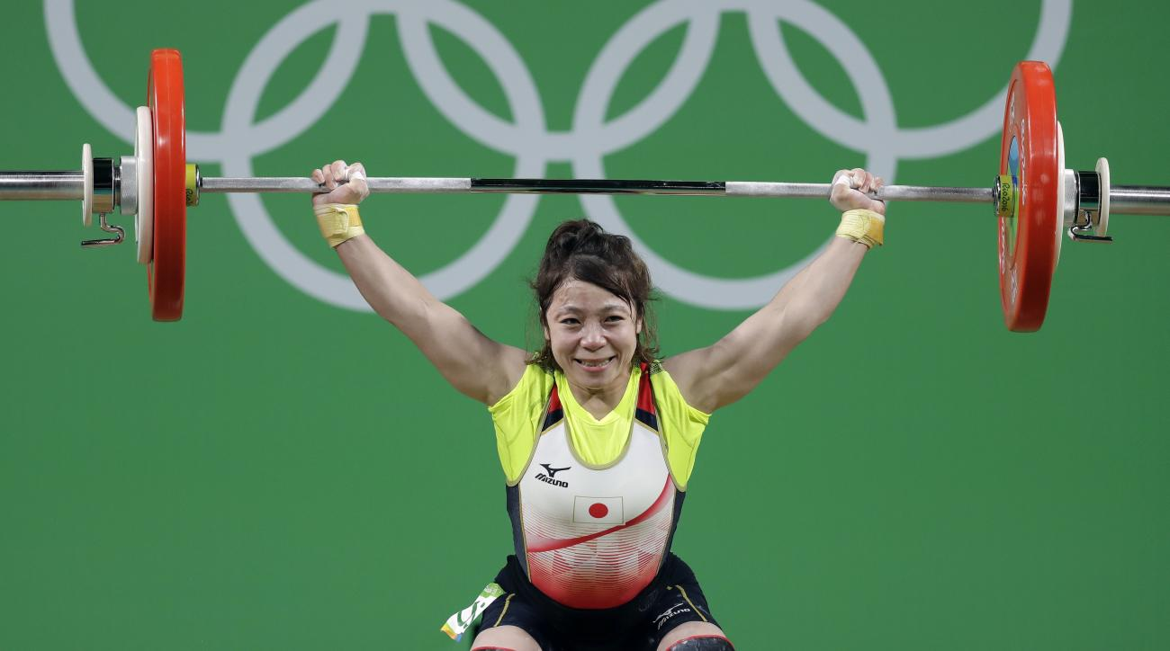 Hiromi Miyake, of Japan, competes in the women's 48kg weightlifting competition at the 2016 Summer Olympics in Rio de Janeiro, Brazil, Saturday, Aug. 6, 2016. (AP Photo/Mike Groll)