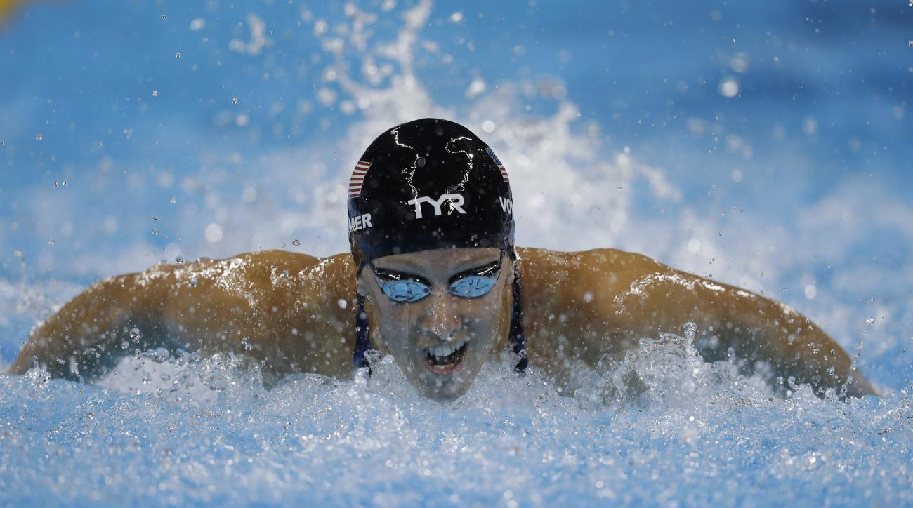 United States' Dana Vollmer competes in a women's 100-meter butterfly semifinal during the swimming competitions at the 2016 Summer Olympics, Saturday, Aug. 6, 2016, in Rio de Janeiro, Brazil. (AP Photo/Michael Sohn)