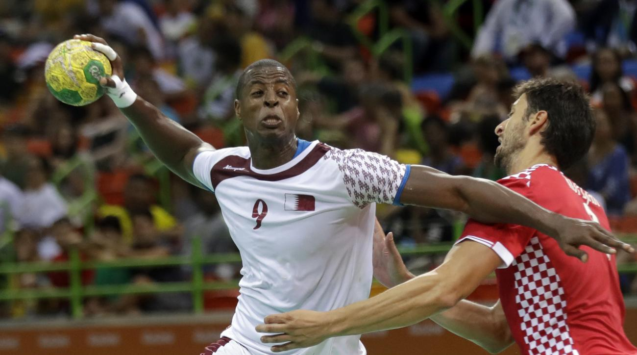 Qatar's Rafael Capote, left, tries to score past Croatia's Marko Kopljar during the men's preliminary handball match between Qatar and Croatia at the 2016 Summer Olympics in Rio de Janeiro, Brazil, Sunday, Aug. 7, 2016. (AP Photo/Ben Curtis)