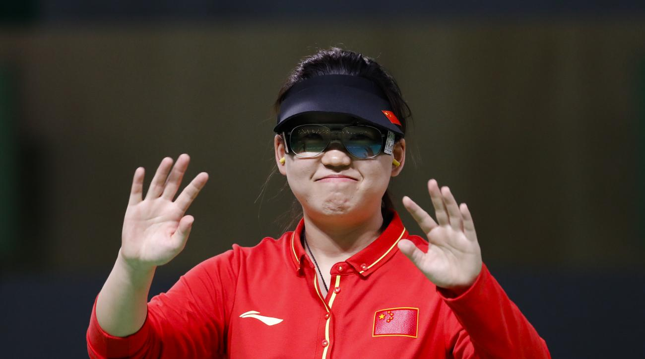 Zhang Mengxue of China celebrates winning the gold medal during the women's 10-meter air pistol event at the 2016 Summer Olympics in Rio de Janeiro, Brazil, Sunday, Aug. 7, 2016. (AP Photo/Hassan Ammar)