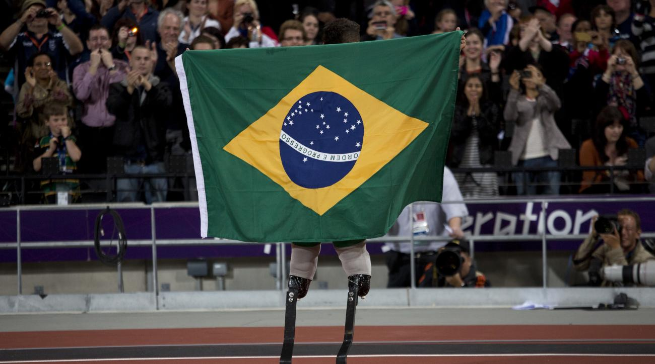 FILE.- In this Sept. 2, 2012 file photo Brazil's Alan Fonteles Cardoso Oliveira celebrates after winning the Men's 200m T44 final at the 2012 London Paralympics.  The countdown clock for the Paralympic Games in Rio de Janeiro reaches 100 days on Monday wi