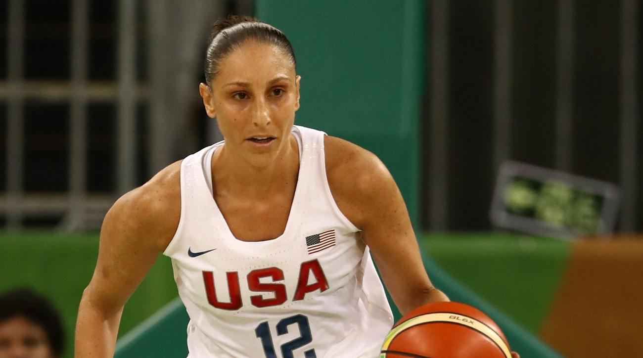 RIO DE JANEIRO, BRAZIL - AUGUST 07:  Diana Taurasi #12 of United States moves the ball during a Women's Preliminary Round basketball game between the United States and Senegal on day 2 of the Rio 2016 Olympics at Carioca Arena 1 on August 7, 2016 in Rio d