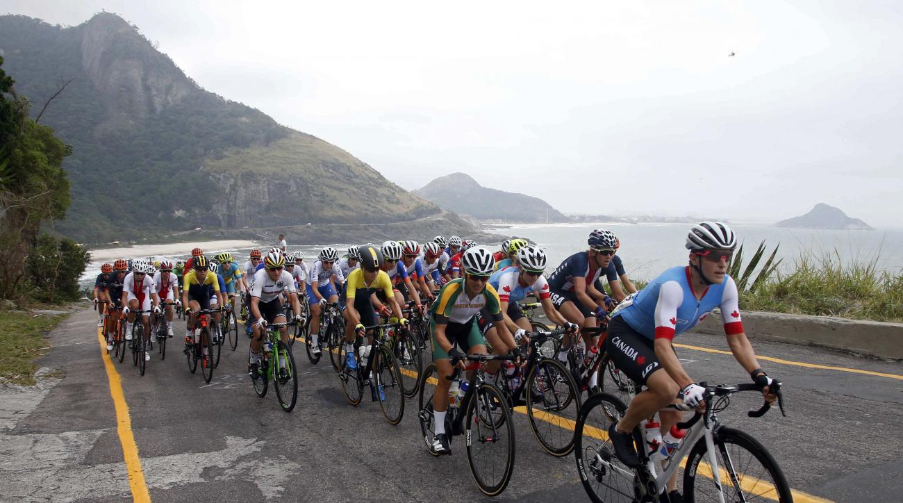 Cyclists compete in the women's road race near Fort Copacabana at the Summer Olympics in Rio de Janeiro, Brazil, Sunday, Aug. 7, 2016. (Eric Gaillard/Pool Photo via AP)