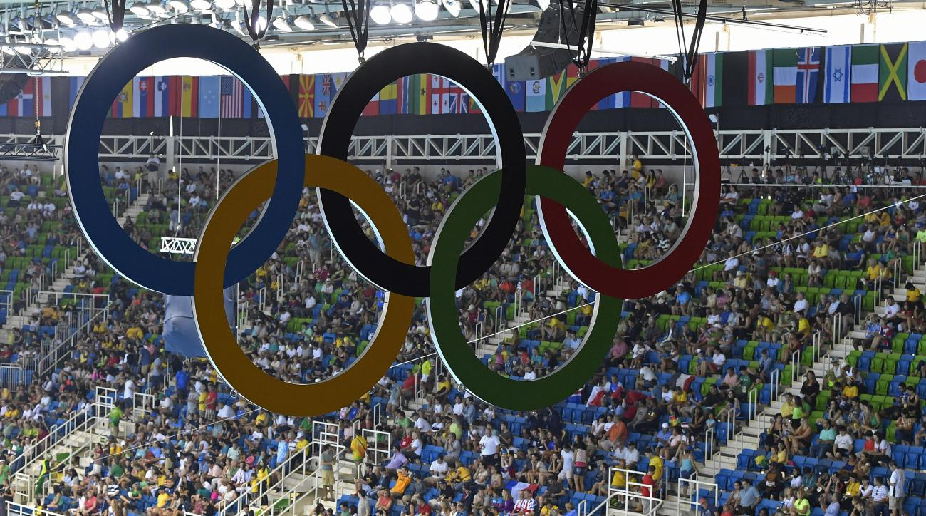 The Olympic rings hang over the spectators of the swimming competitions at the 2016 Summer Olympics, Sunday, Aug. 7, 2016, in Rio de Janeiro, Brazil. (AP Photo/Martin Meissner)