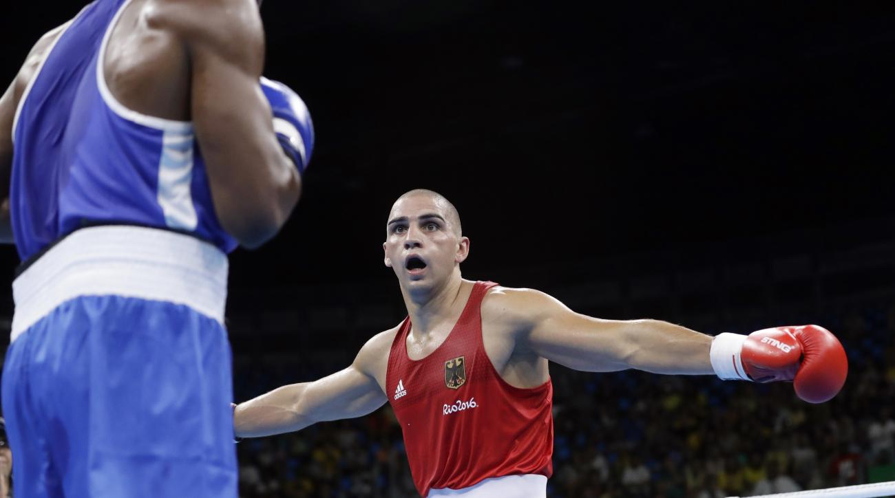 Germany's Serge Michel gestures as he fights Ecuador's Carlos Andres Mina during a men's light heavyweight 81-kg preliminary boxing match at the 2016 Summer Olympics in Rio de Janeiro, Brazil, Sunday, Aug. 7, 2016. (AP Photo/Frank Franklin II)