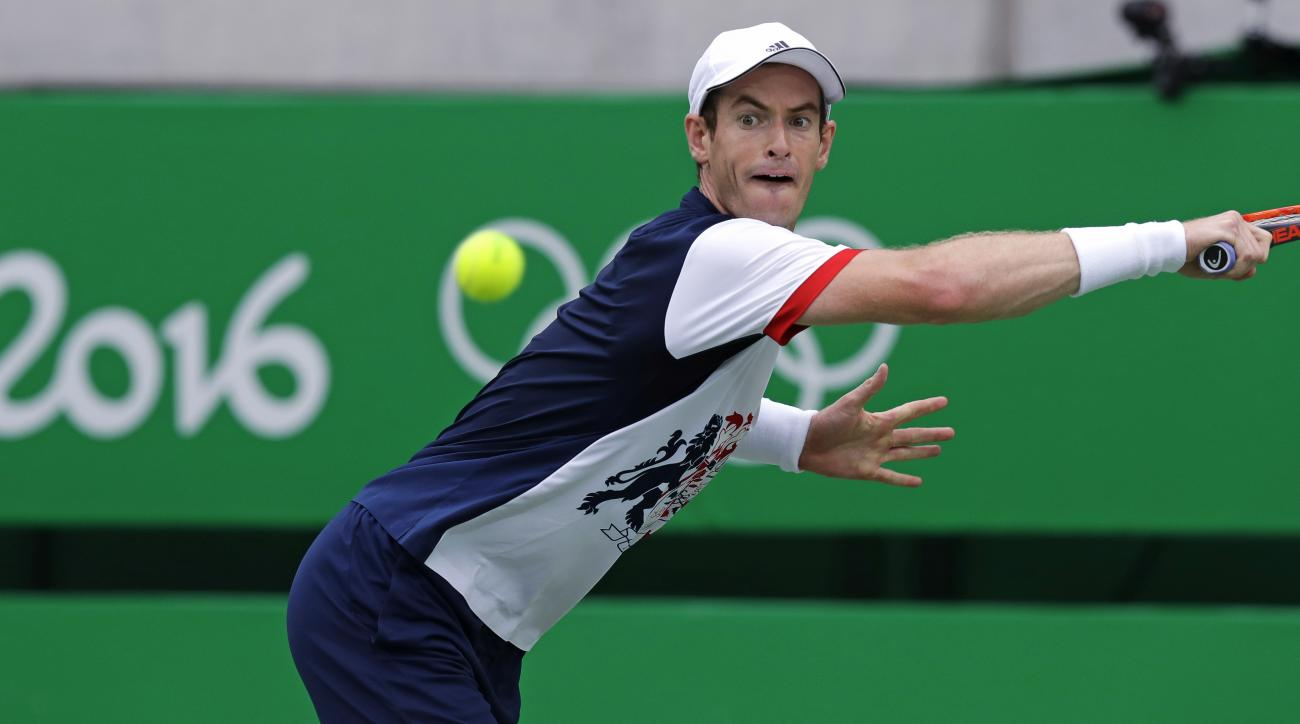Andy Murray, of England, eyes the ball on a return to Viktor Troicki, of Serbia, at the 2016 Summer Olympics in Rio de Janeiro, Brazil, Sunday, Aug. 7, 2016. (AP Photo/Charles Krupa)