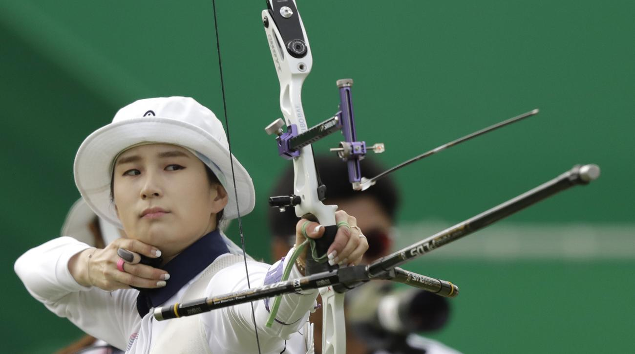 South Korea's Ki Bo-bae releases her arrow during the women's team archery competition at the Sambadrome venue during the 2016 Summer Olympics in Rio de Janeiro, Brazil, Sunday, Aug. 7, 2016. (AP Photo/Natacha Pisarenko)
