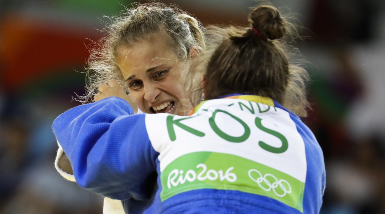 Italy's Odette Giuffrida competes against Kosovo's Majlinda Kelmendi during the finals the women's 52-kg judo competition at the 2016 Summer Olympics in Rio de Janeiro, Brazil, Sunday, Aug. 7, 2016. (AP Photo/Markus Schreiber)