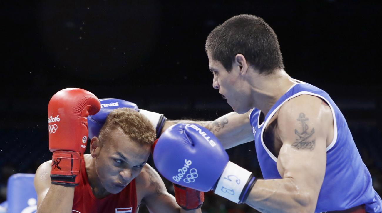Argentina's Perrin Ignacio, left, fights Thailand's Amnat Ruenroeng during a men's lightweight 60-kg preliminary boxing match at the 2016 Summer Olympics in Rio de Janeiro, Brazil, Sunday, Aug. 7, 2016. (AP Photo/Frank Franklin II)