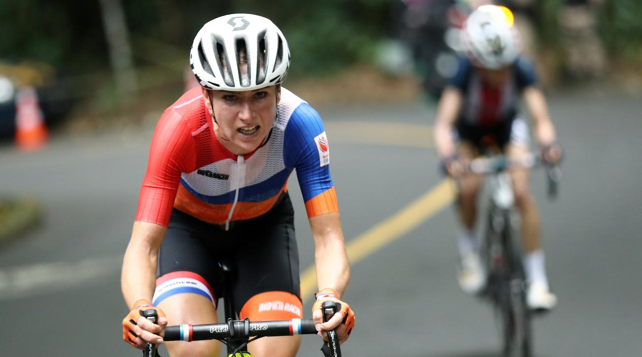 Annemiek van Vleuten, of the Netherlands, leads Mara Abbott, of the United States, during the women's cycling road race at the 2016 Summer Olympics in Rio de Janeiro, Brazil, Sunday, Aug. 7, 2016. (Bryn Lennon/Pool Photo via AP)