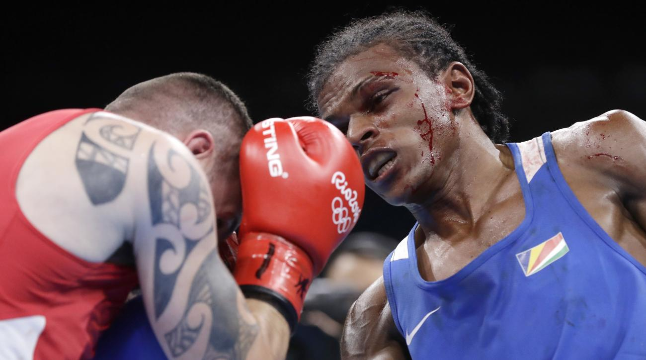 Seychelles' Andrique Allisop, right, fights Ireland's David Joyce during a men's lightweight 60-kg preliminary boxing match at the 2016 Summer Olympics in Rio de Janeiro, Brazil, Sunday, Aug. 7, 2016. (AP Photo/Frank Franklin II)